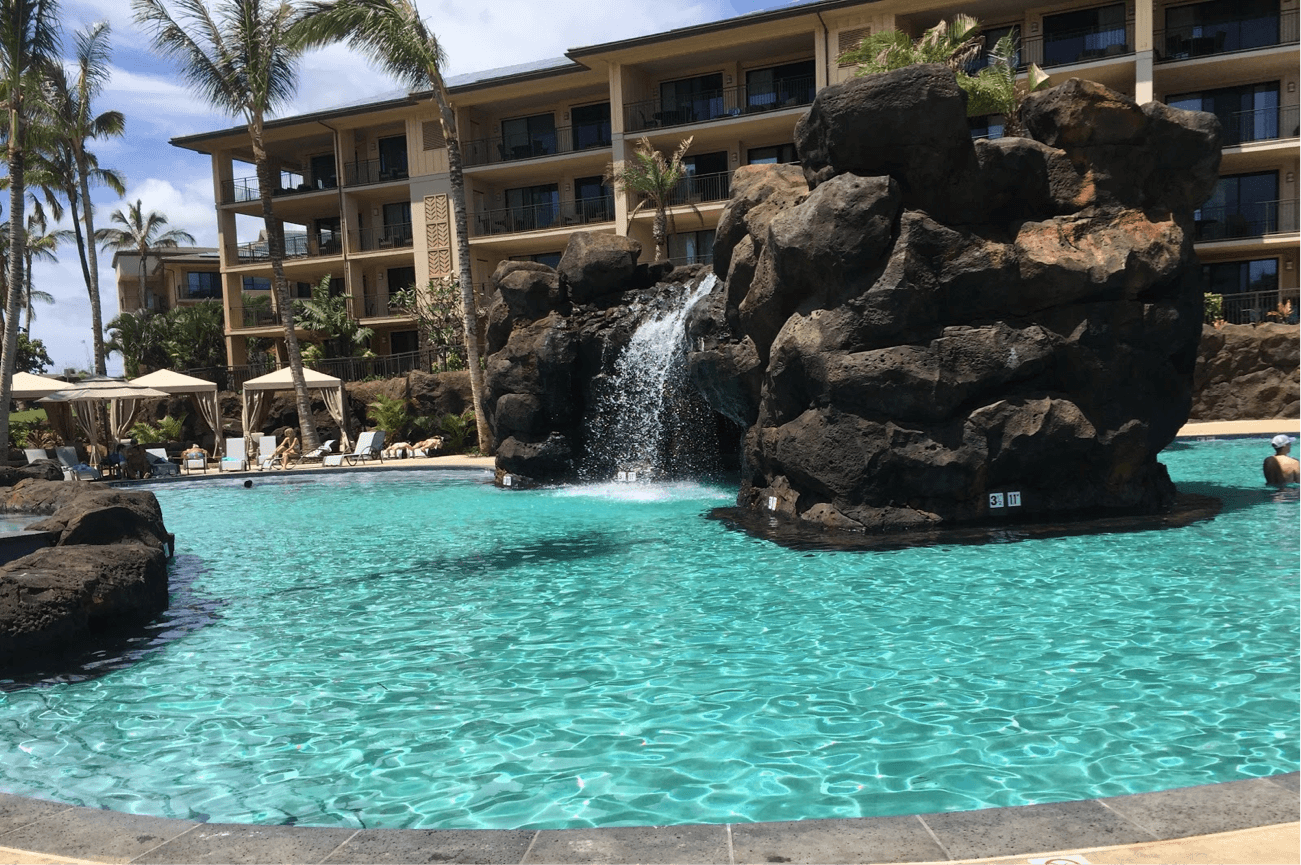 pool with a waterfall in kauai