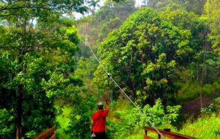 Guest enjoying ziplining in Poipu